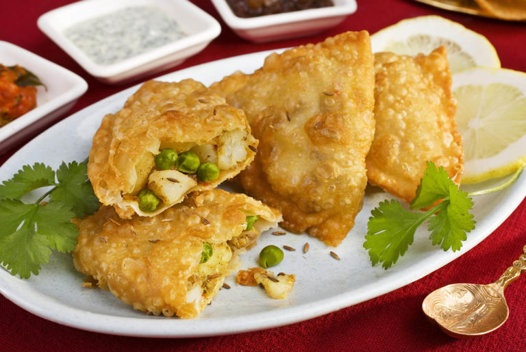 Samosas vegetables filling lemon sause table plate spoon